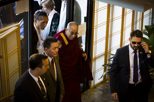 His Holiness the Dalai Lama entering building shared by Maitripa College and FPMT International Office with Yangsi Rinpoche, Portland, Oregon, U.S., May 10, 2013. Photo by Leah Nash.