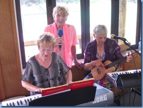 The intrepid trio jamming. Diane Lyons on the keys, Margaret Black vocals, and Jeanette Harding on her Eukulele.