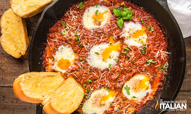 Baked Eggs in a skillet of sauce