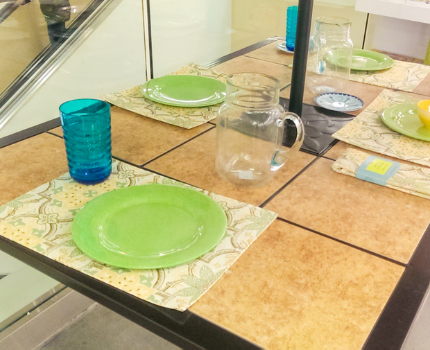 photo of an outdoor dining table with place settings