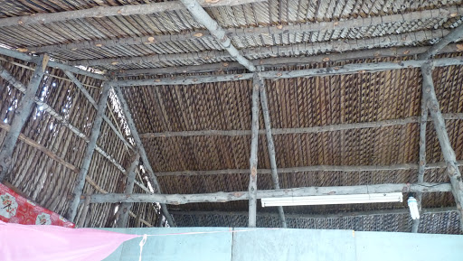 Roofing Design And Material. Melaluca Poles With Coconut Leaf Thatching.