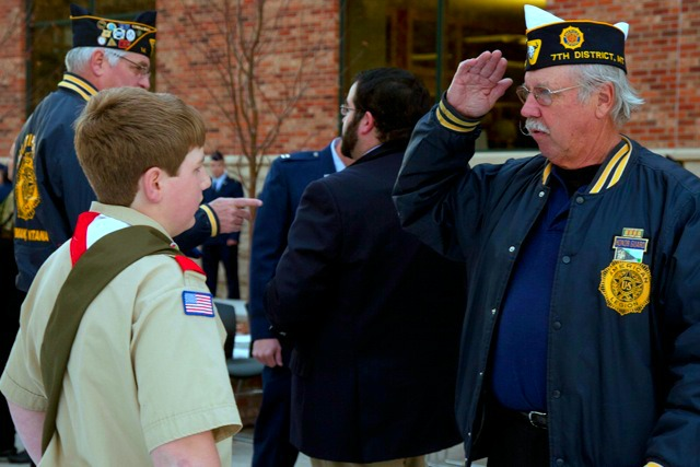 Len Albright, Legion Director for Gallatin County American Legion, salutes Eagle Scout Nelson Brown, 14, at a flag dedication ceremony in Bozeman. The flag was raised on Veterans' Day 2011, in honor of all veterans at the Travis Atkins Memorial Grove as Brown's Eagle Scout project. Photo by Ryan Grove.