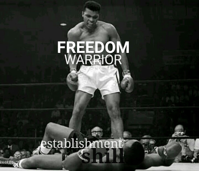 Muhammad Ali boxer winning fight standing triumphant angry