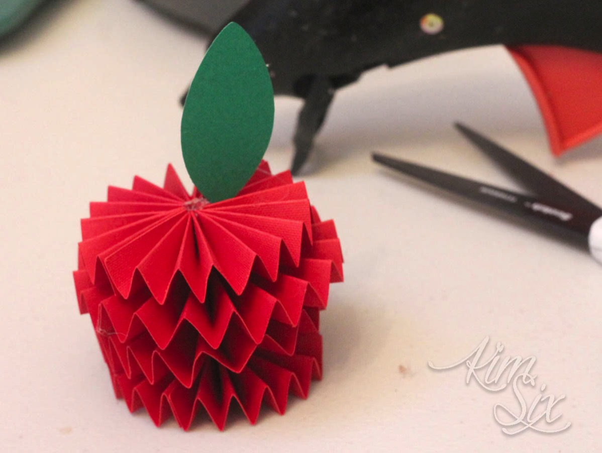 Paper leaves on origami apple