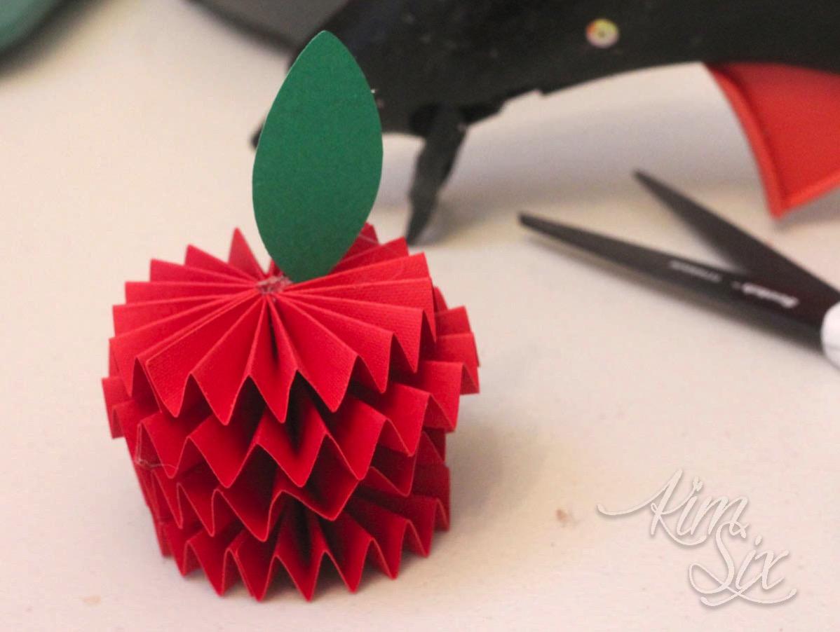 Paper leaves on origami apple