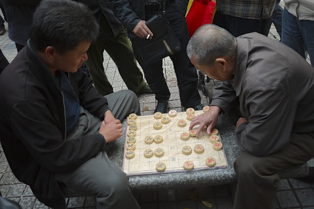 men playing Chinese chess (xiangqi) in Changsha, China