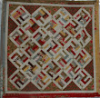 This is a Jelly Roll quilt made for us by some of the longarmers in the UK when we got married in 2008. Quilted by Mandy Parks of The Quilt's Whiskers