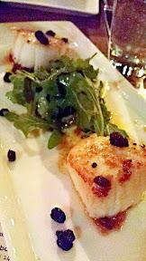 Zeus Cafe appetizer of seared sea scallops, arugula, currants, and chorizo vinaigrette
