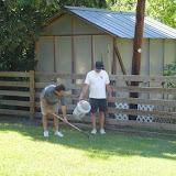 Gary and Brian pick up dog poop.