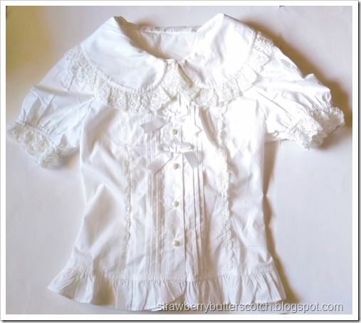 The madeover Bodyline blouse l015.  The extra row of lace on the collar has been removed along with the bows on the sleeves.