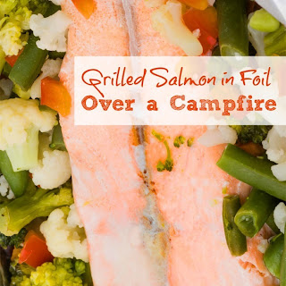 Grilled Salmon in Foil Over a Campfire.