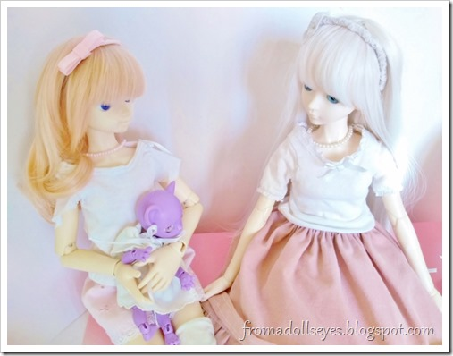 The kitty doll is sitting in Usagi's lap and staring at Hikaru and her skirt.  Hikaru is commenting on the cat.