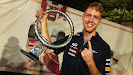 Sebastian Vettel with finger and 2012 Singapore trophy