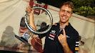 Sebastian Vettel with finger and 2012 Singapore trophy