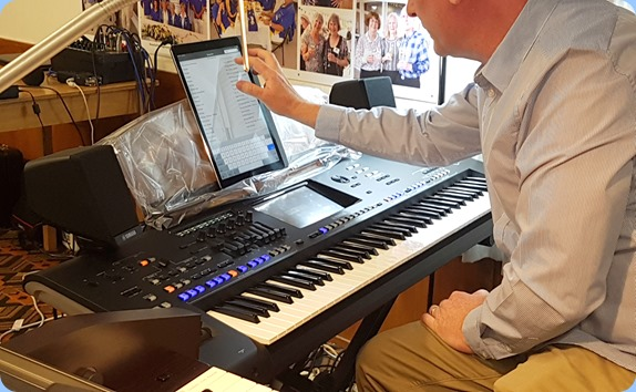 Darren Smith setting up to play the latest Yamaha arranger keyboard, the Genos. Darren uses an iPad for his music notation/chords/song notes.