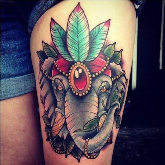 cabeça_de_elefante_com_uma_tribal_cocar_coxa_tatuagem