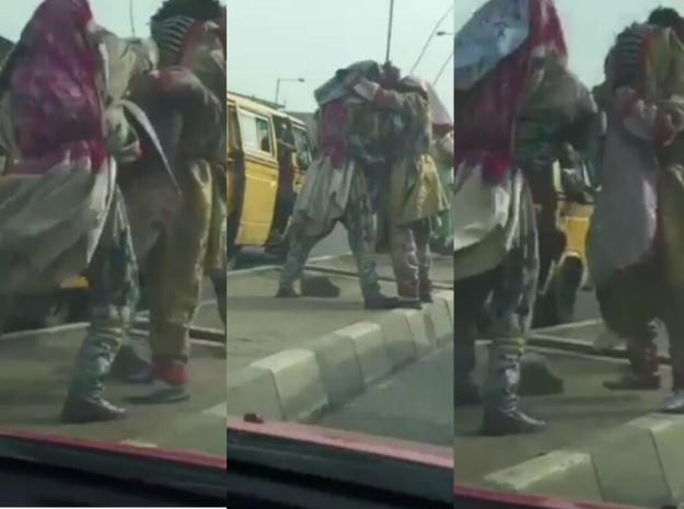 Two Masquerades Pictured Fighting On The Road In Lagos