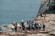 Korea.net team enjoying their time along the magnificent cliffs of Taejongdae facing the open sea on the southernmost tip of the Yeongdo island.