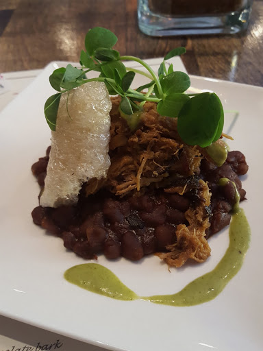 BBQ Smoked pork shoulder with Newfoundland Molasses Baked Beans, a roll of crispy chicarron, and a swoosh of arugula puree. at Tavola, St. John's, Newfoundland - one of my top meals in 2015