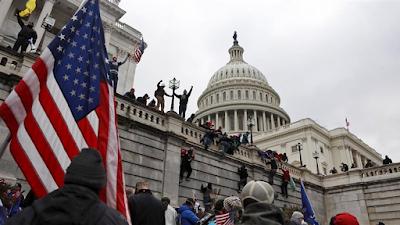 Trump supporters climb Capitol walls