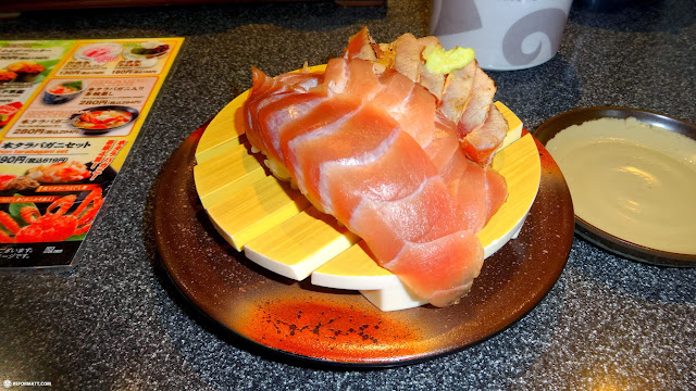 conveybelt meguro sushi on Omotesando dori in Roppongi, Tokyo, Japan