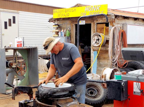 Dave at Rabbitbrush Repair replacing a tire