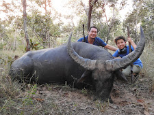 Mr Kooijmann and his son with a great buffalo bull, Carmor Plains