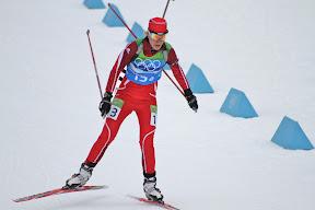 Latvian skiier finishing the race