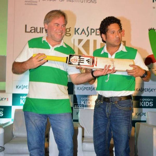 Sachin Tendulkar, presents an autographed cricket bat to Eugene Kaspersky, Chairman & CEO, Kaspersky Lab, during Kaspersky Kids awareness programme, held at Ryan International School, on July 23, 2014. (Pic: Viral Bhayani)