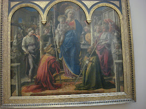 Virgin and Child Surrounded by Angels with St. Frediano and St. Augustine (The Barbadori Altarpiece) - Fra Filippo Lippi