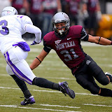 Grizzly safety, Andrew Badger, tries to tackle Central Arkansas wide receiver, Isaiah Jackson.
