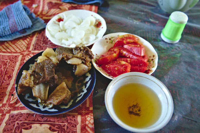 A tipical roadside meal in Uzbekistan (for about 2 dollars). Enjoying sheep meet really helps in Central Asia.