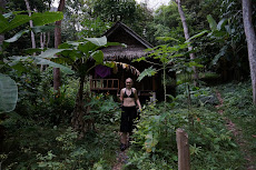 Me coming out of our bungalow in the jungle on Ton Sai
