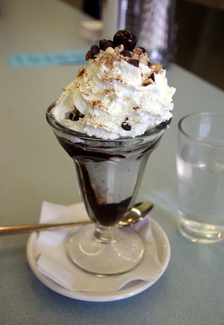 Heidi enjoyed a Canadian Mint sundae which contains mint chocolate chip ice cream, hot fudge, and toasted almonds.