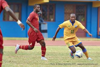 Photo: Jean-Claude IRANZI (12) moves past Wakaso Mubarak (11) [Rwanda Vs Ghana AFCON2017 Qualifier, 5 Sep 2015 in Kigali, Rwanda.  Photo © Darren McKinstry 2015