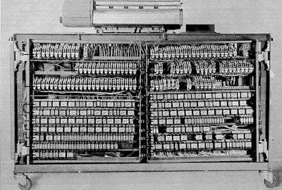 The back of the IBM 403 accounting machine shows numerous relays, used to control the machine.
