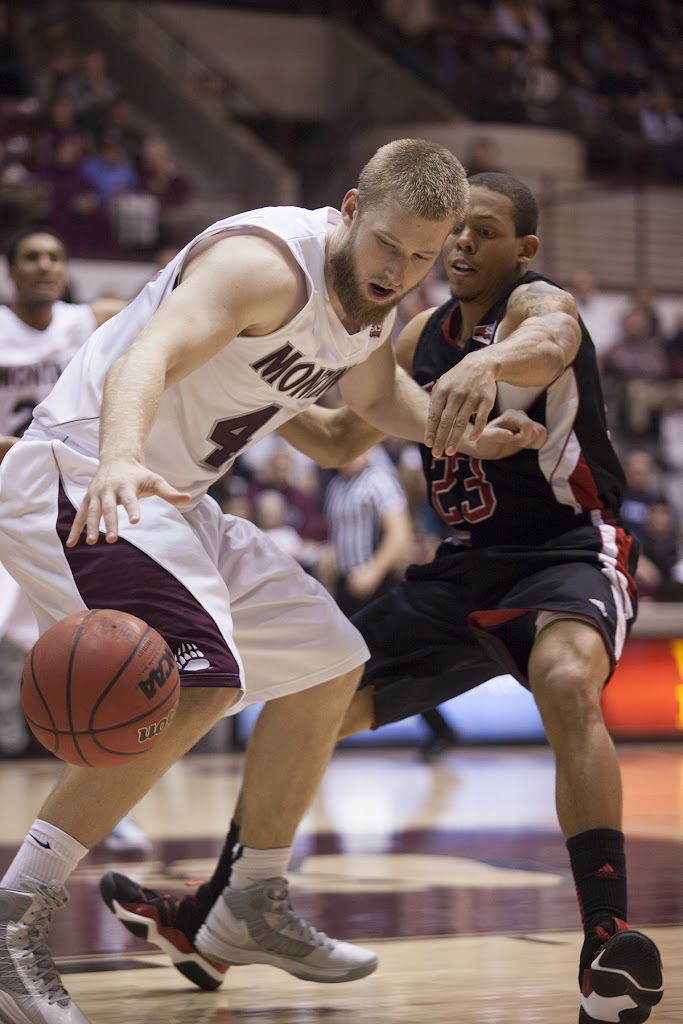 Mathias Ward and Kevin Winford (#23) fight for possession early in Thursday's contest.  Dahlberg Arena in Missoula, Mont., January 3rd, 2013.