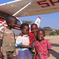 Some of our neighbor kid friends on the airstrip in Magambua