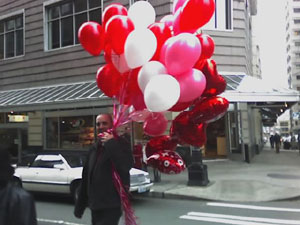 I saw this man walking out of a flower shop in downtown Seattle. I thought it was a good image for the day. Photo taken on February 14, 2007.
