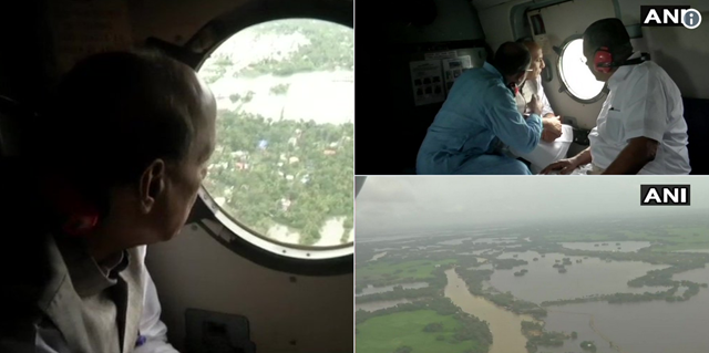 Home Minister Rajnath Singh conducts an aerial survey of the flood-affected regions of Kerala state, 12 August 2018. CM Pinarayi Vijayan and Union Minister KJ Alphons are also with him. Photo: ANI