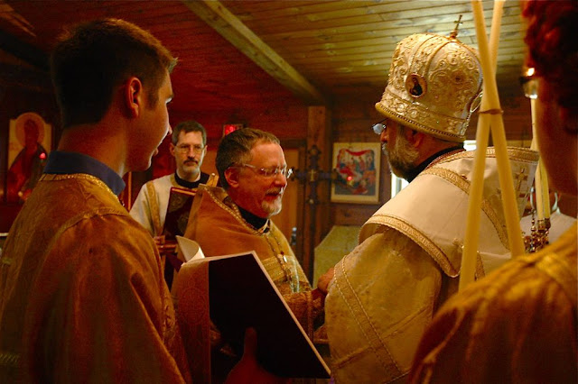 Vladyka congratulates the newly-elevated Archpriest John.