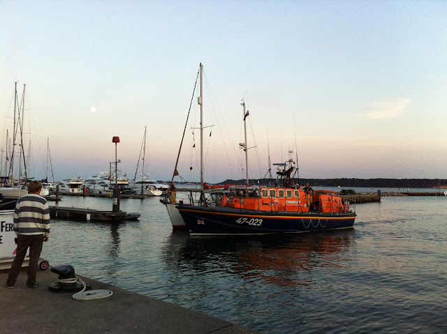 The ALB escorts the 9.5m motor sailing vessel towards Poole Quay - 19 August 2013.  Photo credit: Nathan Evans.