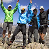 "Shelli, with her Besties, HoPS, Doyle and SoX, at the top of Mitchell Peak during a ""test drive"" of her Epic Women route."