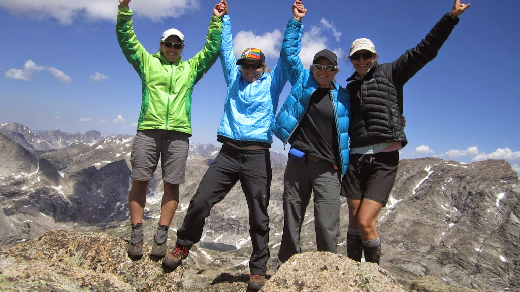"""Shelli, with her Besties, HoPS, Doyle and SoX, at the top of Mitchell Peak during a """"test drive"""" of her Epic Women route."""