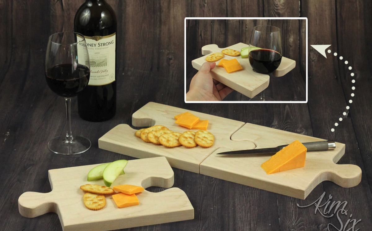A set of puzzle piece shaped cutting boards that combine together to form one large cutting board, or seperated can be used individually as serving trays with built in wine glass holders.jpg