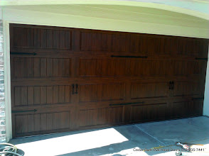 Photo: Clopay 16 x 7  GD1LP Double steel garage door with Dark Oak UltraGrain Finish. Installed by Cedar Park Overhead Doors 512-335-7441
