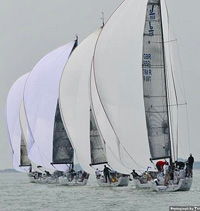 J/111 one-design sailboats- sailing in formation