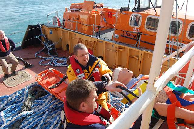 The casualty (a dummy!) being transferred from the tug - Training exercise, 19 February 2012
