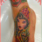 Doll tattooed on the foot with a rose and skull - tattoo meanings