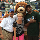 Charlie, the Riverdogs' mascot, poses for a picture with attorneys Peter Shahid (left) and Emmanual Ferguson (right), and CCBA PR consultant Maria Aselage (center).